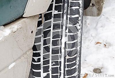 Closeup car tire tread protector full snow winter