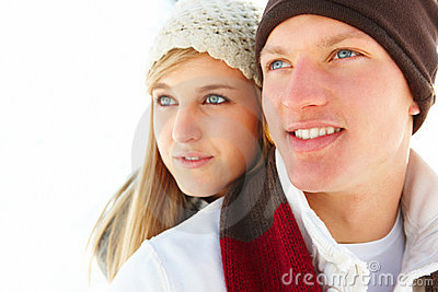 Closeup of a charming young couple looking away