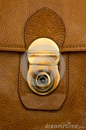 Closeup of clasp on  battered, leather  briefcase