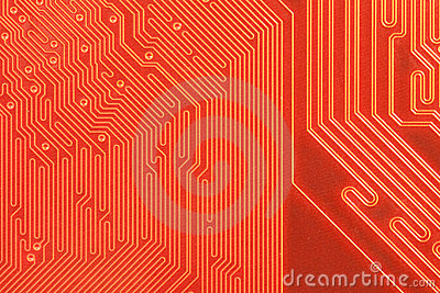 Closeup of computer circuit board in orange