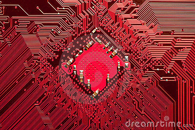 Closeup of computer circuit board in red