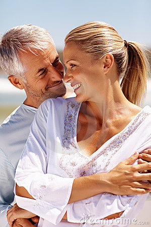 Closeup of a couple on a sunny day at the beach