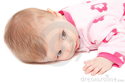 Closeup of cute baby girl in pink isolated