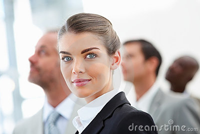 Closeup of a cute business woman with colleagues