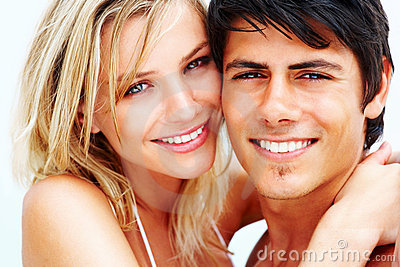 Closeup of a cute young woman with her boyfriend