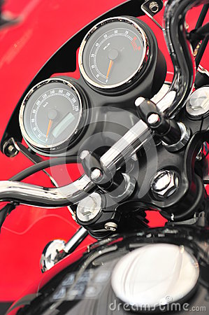 Motorcycle cockpit - revs and mileage gages closeup