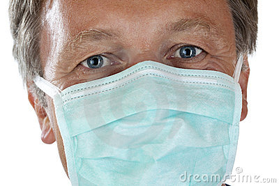 Closeup of doctor s face protected with mask