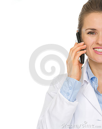 Closeup on doctor woman speaking mobile phone
