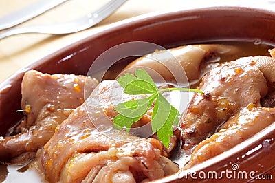 Manitas de cerdo, stewed pig feet typical of Spain