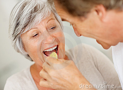 Closeup Of An Elderly Man Feeding A Woman Royalty Free Stock Photo - Image: 15723745