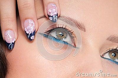 Closeup eyes make-up zone. Nail art