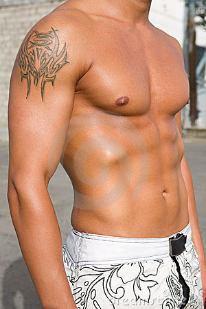 Closeup of fit boy with tattoo