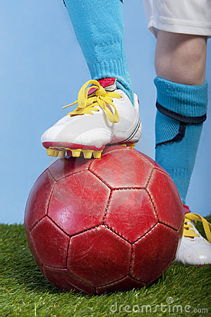 Closeup on foot and soccer ball