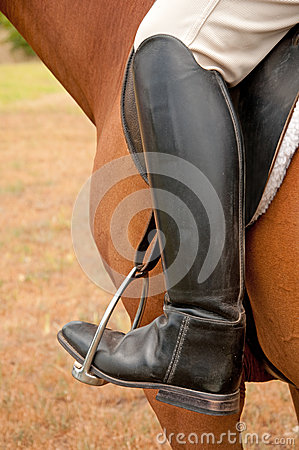 Closeup of a foot in a stirrup