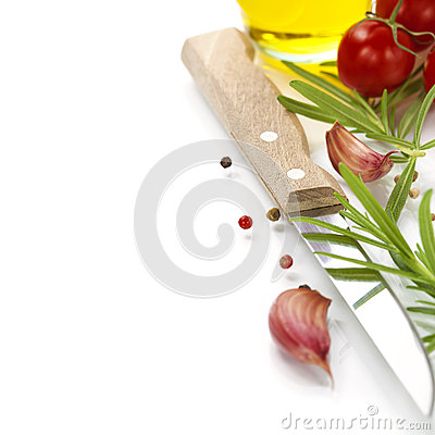 Closeup of garlic,rosemary, tomatoe, olive oil  and knife