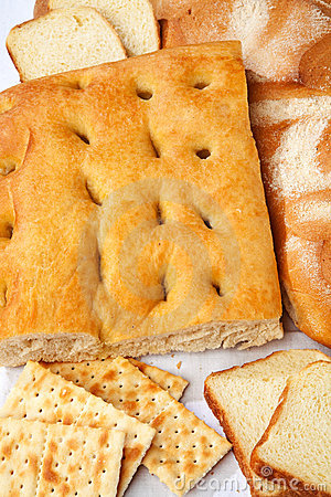 Closeup of genoese focaccia, bread and crackers.