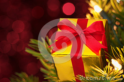 Closeup of gift on Christmas tree.(horizontal)