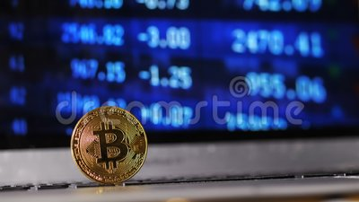 Closeup Bitcoin Model Continues Grow against World Lowering. Closeup golden bitcoin model continues grow and becomes popular against world lowering cost stock video footage