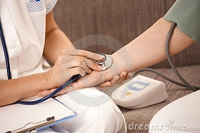 Closeup of hand using stethoscope on wrist