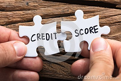 Hands Connecting Credit Score Jigsaw Pieces Stock Photo