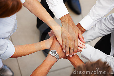 Closeup of hands together showing signs of unity