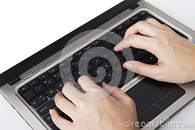 Closeup of hands typing