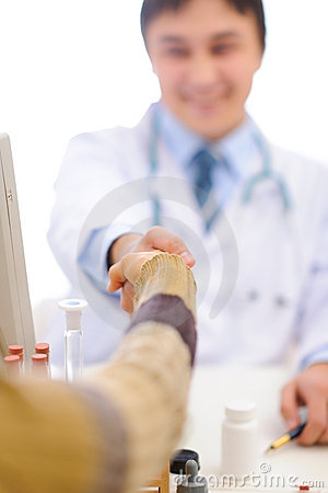 Closeup on handshake of medical doctor and patient
