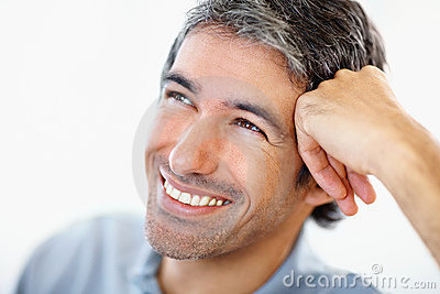 Closeup of a happy man resting his head on hand