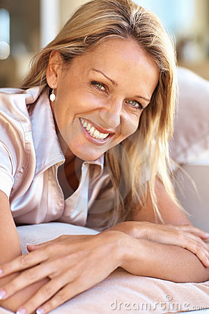 Closeup of a happy mid adult woman relaxing