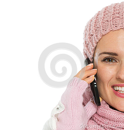 Closeup on happy woman speaking mobile