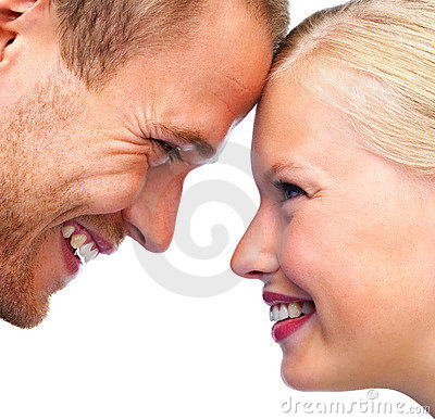 Closeup of a happy young couple face to face