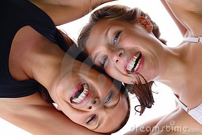 Closeup of happy young girls laughing