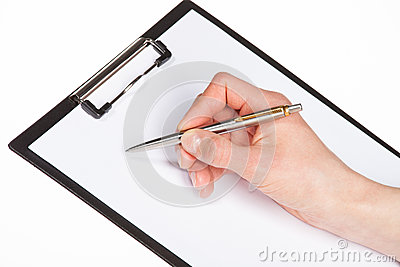 Closeup of a human hand writing with pen on clipboard