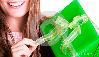 Closeup of human person with box gift. Birthday.