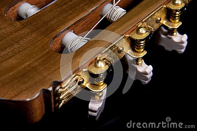 Closeup image of gold plated classical guitar tune