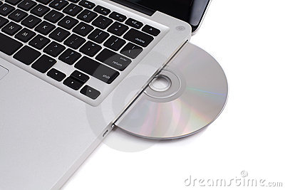 Closeup image from a laptop and a CDRom