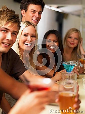 Closeup of joyful young people having drinks