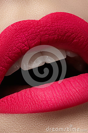 Closeup of lips makeup. Beautiful fashion bright pink lip mat make-up