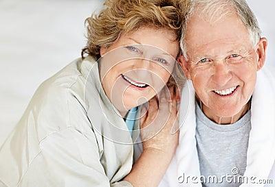 Closeup of a loving elderly couple having fun