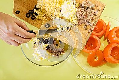 Closeup of making stuff for  farci tomato salad