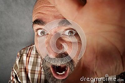 Closeup of man in his 40s screaming