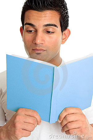 Closeup of a man reading a book