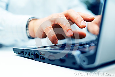 Closeup of man typing