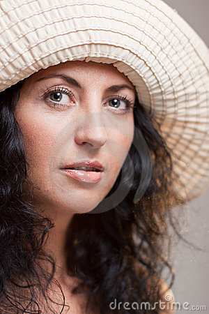 Closeup of mature woman in a hat