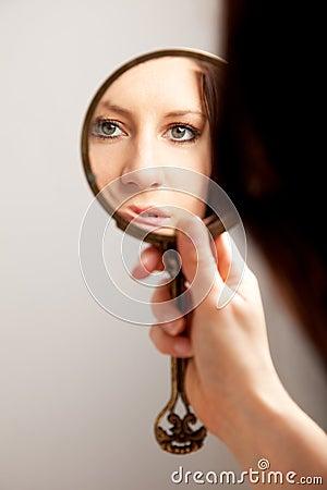 Closeup Mirror Reflection of a Woman s Face