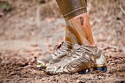 Closeup of mud race runner s muddy feet Editorial Stock Image