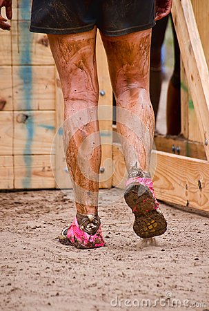 Closeup of mud race runner s muddy legs Editorial Photo
