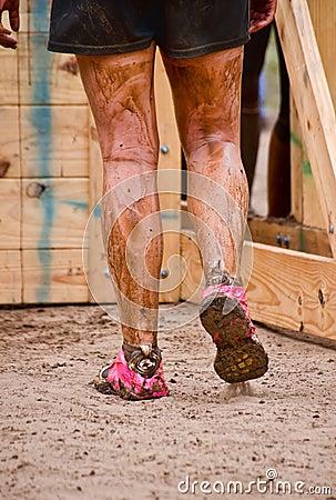 Closeup of mud race runner s muddy legs Editorial Photo