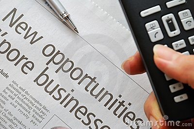 Closeup on new opportunities text and hand phone