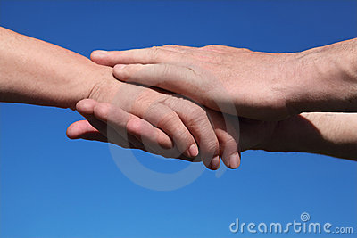 Closeup of old man holding hand of old woman Stock Photo